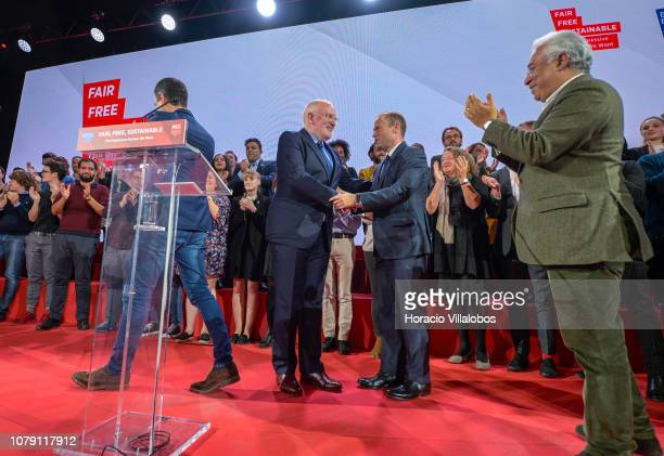 Portuguese Prime Minister Antonio Costa applauds while Frans Timmerman PES Common Candidate Designate to preside European Commission is congratulated...