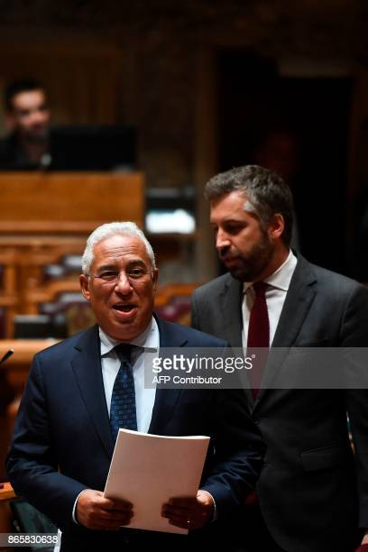 Portuguese Prime Minister Antonio Costa arrives with Parliamentary Affairs Minister Pedro Nuno Santos for the debate of a censure motion tabled by...
