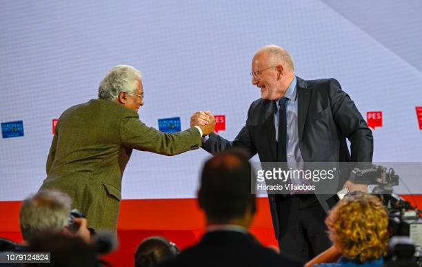 Portuguese Prime Minister Antonio Costa celebrates with Frans Timmerman PES Common Candidate Designate to preside European Commission at the end of...