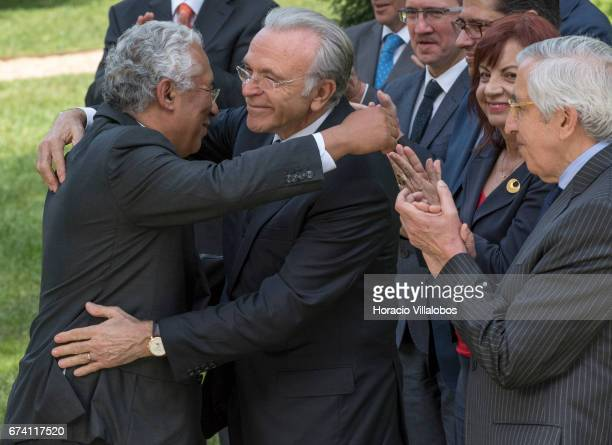 Portuguese Prime Minister Antonio Costa embraces with the president of the Banking Foundation 'La Caixa' Isidro Faine as the honorary president of...