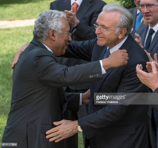 Portuguese Prime Minister Antonio Costa embraces with the president of the Banking Foundation 'La Caixa' Isidro Faine at the end of their meeting at...