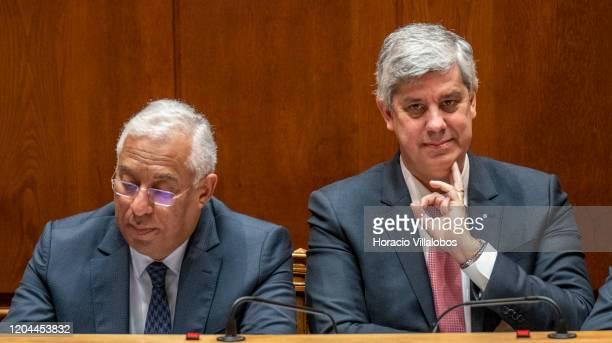 Portuguese Prime Minister Antonio Costa Finance Minister Mario Centeno listen to opposition leaders remarks during the debate in the Assembleia da...
