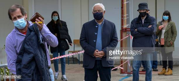 Portuguese Prime Minister Antonio Costa queues in Jorge Barradas School to cast his ballot in the presidential election during the COVID-19...