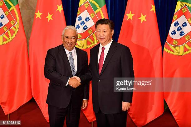 Portuguese Prime Minister Antonio Costa shakes hands with Chinese President Xi Jinping before their meeting at the Great Hall of the People in...