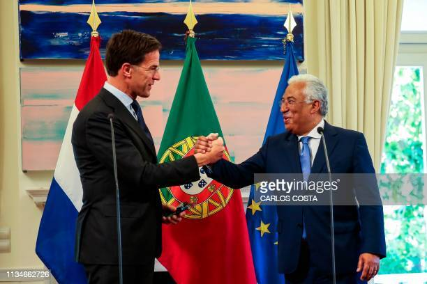 Portuguese Prime Minister Antonio Costa shakes hands with Dutch Prime Minister Mark Rutte during a joint press conference at Sao Bento Palace in...