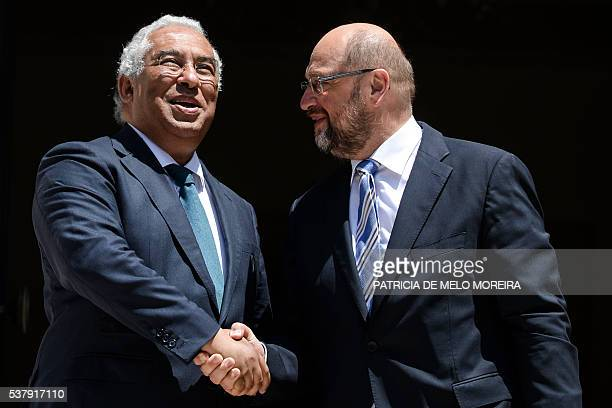 Portuguese Prime Minister Antonio Costa shakes hands with European Union President Martin Schulz at Sao Bento Palace in Lisbon on June 3 2016 / AFP /...