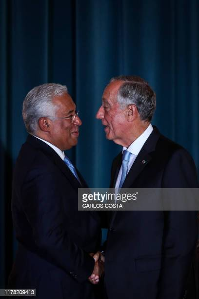 Portuguese Prime Minister Antonio Costa shakes hands with Portuguese President Marcelo Rebelo de Sousa during the swearing-in ceremony of the new...