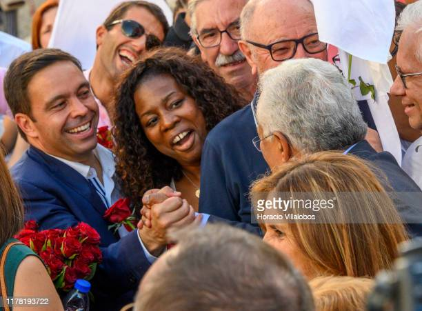 Portuguese Prime Minister Antonio Costa shakes hands with supporters while walking accompanied by his wife Fernanda Maria Gonçalves Tadeu along Rua...