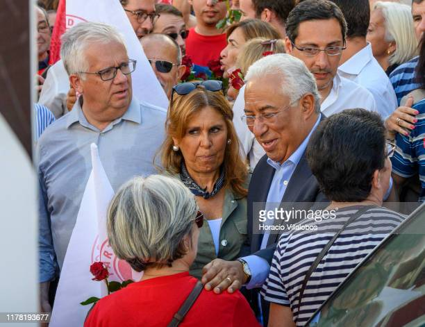 Portuguese Prime Minister Antonio Costa smeets supporters while walking accompanied by his wife Fernanda Maria Gonçalves Tadeu along Rua Cândido dos...