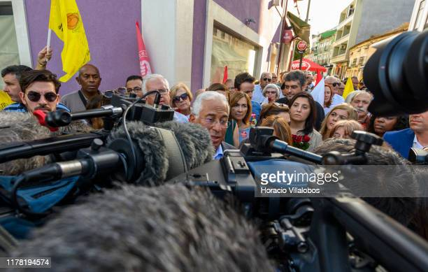 Portuguese Prime Minister Antonio Costa talks to journalists while meeting supporters accompanied by his wife Fernanda Maria Gonçalves Tadeu along...