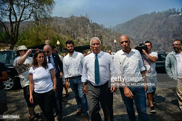Portuguese Prime Minister Antonio Costa visits a fire affected area in Babosas Funchal in Madeira island on August 11 2016 The situation on the fire...