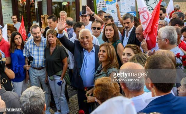 Portuguese Prime Minister Antonio Costa waves while meeting supporters accompanied by his wife Fernanda Maria Gonçalves Tadeu along Rua Cândido dos...