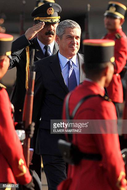 Portuguese Prime Minister Jose Socrates receives military honours upon his arrival to El Salvador's airport in Comalapa some 45 kms south of San...