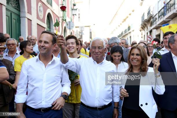 Portuguese Prime Minister, leader and candidate of the Socialist Party Antonio Costa greets supporters with his wife Fernanda Tadeu and Mayor of...
