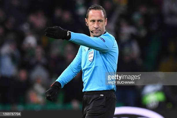 Portuguese referee Artur Dias indicates a penalty to Celtic after consulting the during the UEFA Europa League round of 32 second leg football match...