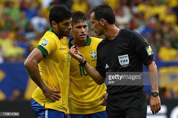 Portuguese referee Pedro Proenca talks to Brazil's forward Hulk as Brazil's forward Neymar looks on during their FIFA Confederations Cup Brazil 2013...