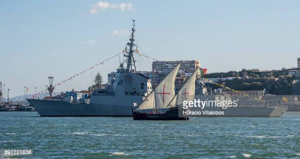 Portuguese replica of XV century caravel Vera Cruz sails the Tagus River by Spanish frigate Alvaro de Bazan during the commemoration day of the...