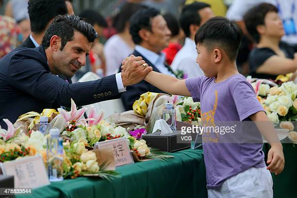 Portuguese retired footballer Luis Figo meets fans at FF sport park on June 27 2015 in Chengdu China