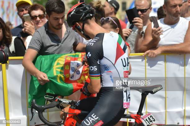 Portuguese rider Rui Alberto Faria da Costa from UAE Emirates team signs autographs to his fan ahead of the opening stage a 130km with start and...