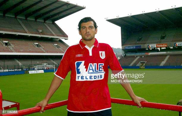 Portuguese Sergio Marceneiro da Conceicao poses with his new jersey inside the stadium of the Standard football club 10 August 2004 in Liege after...