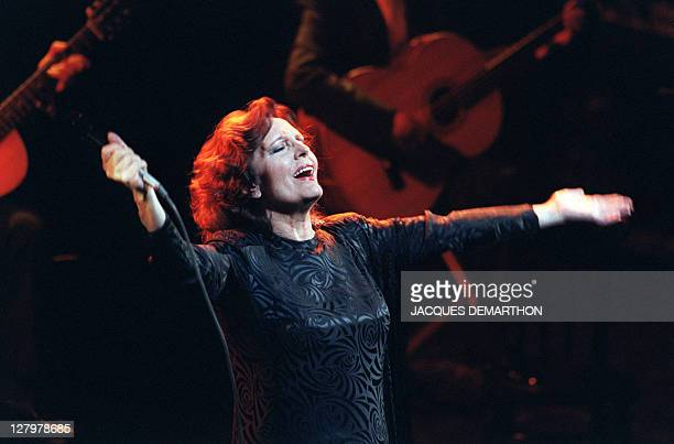 Portuguese singer Amalia Rodrigues performs on the Olympia concert hall stage on April 21 1987 in Paris Rodrigues' speciality was fado traditional...