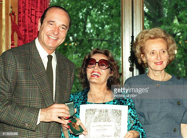 Portuguese singer Amalia Rodrigues the diva of fado smiles after being awarded 11 May 1989 in Paris by Paris Mayor Jacques Chirac the Medal of the...