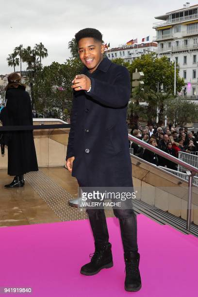 Portuguese singer Lisandro Cuxi, winner of the 6th season of The Voice, poses as he arrives for the opening of the Canneseries Television Festival in...