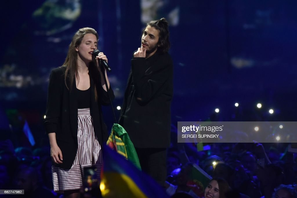 Portuguese singer representing Portugal with the song 'Amar Pelos Dios' Salvador Vilar Braamcamp Sobral aka Salvador Sobral (R) performs on stage with his sister Luisa Sobral after winning the final of the 62nd edition of the Eurovision Song Contest 2017 Grand Final at the International Exhibition Centre in Kiev, on May 13, 2017. / AFP PHOTO / Sergei SUPINSKY