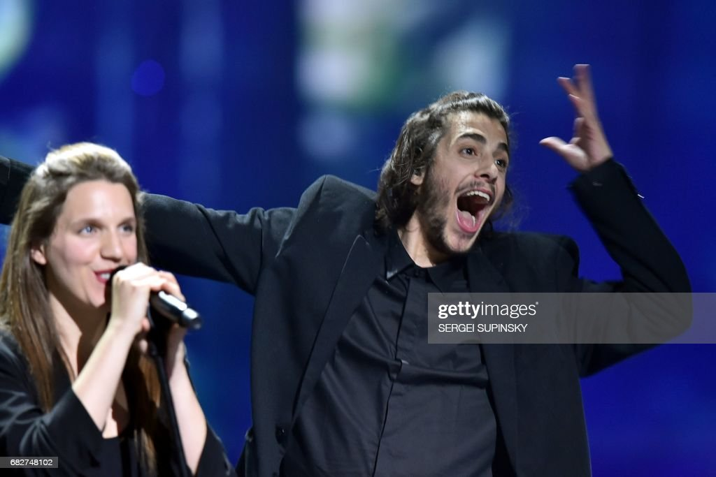 Portuguese singer representing Portugal with the song 'Amar Pelos Dios' Salvador Vilar Braamcamp Sobral aka Salvador Sobral (R) performs on stage with his sister Luisa Sobral after winning the final of the 62nd edition of the Eurovision Song Contest 2017 Grand Final at the International Exhibition Centre in Kiev, on May 13, 2017. /