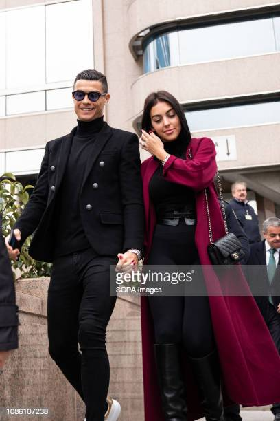 Portuguese soccer player Cristiano Ronaldo leaves from the provincial court of Madrid with his girlfriend Georgina Rodriguez from his tax evasion...