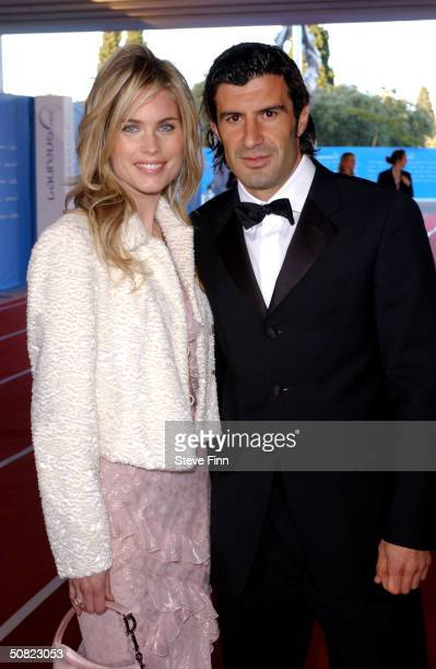 Portuguese soccer star Luis Figo arrives with a Helen Syelin at the the Laureus World Sports Awards May 10, 2004 in Estoril, Portugal.