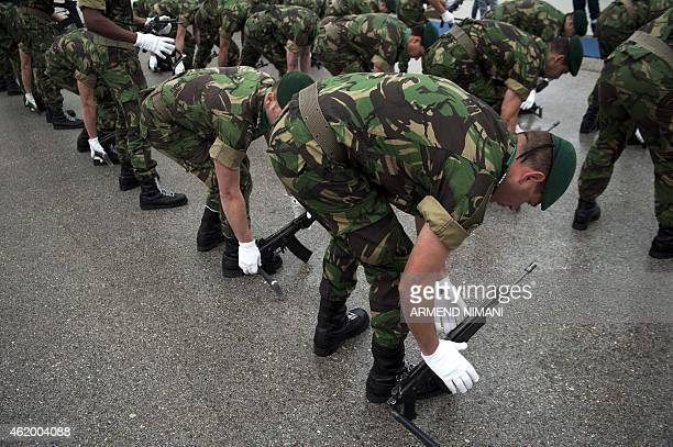 Portuguese soldiers serving in the North Atlantic Treaty Organization led peacekeeping mission in Kosovo arrange their arms before the arrival of the...