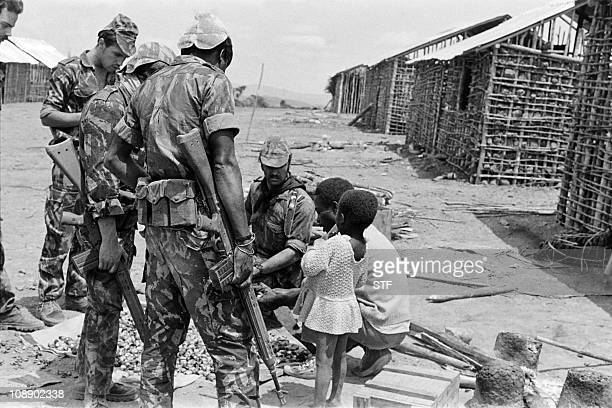 Portuguese soldiers talk with an Angolese man during a patrol on September 10 1974 near Santa Eulalia After independence Angola was the scene of an...