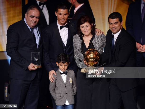 Portuguese striker Cristiano Ronaldo poses for photographers with his son Cristiano Jr., his mother Maria Dolores dos Santos Aveiro and his brother...