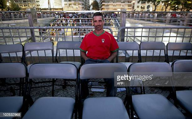 A Portuguese supporter sits at the end of the 2010 World Cup football game between Portugal and Spain in Campo Pequeno Square in Lisbon on June 29...