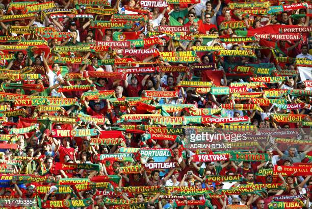 Portuguese supporters cheer their team, 30 June 2004 at Alvalade stadium in Lisbon, before the beginning of the Euro 2004 semi-final football match...