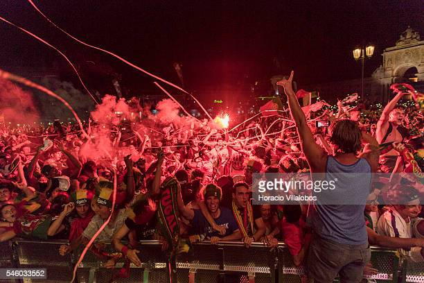 Portuguese supporters jubilate at their national team victory over France at the end of the match they watched for the final of UEFA Euro 2016 on a...