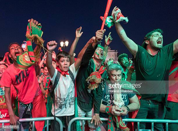 Portuguese supporters jubilate at their national team victory while watching it playing against Wales for semi-finals of UEFA Euro 2016 on a giant...
