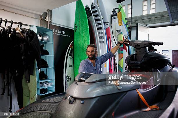 Portuguese surfer Hugo Vau does the maintenance of his jet ski after a big wave session on December 17 2016 in Nazare Portugal Nazare's giant waves...