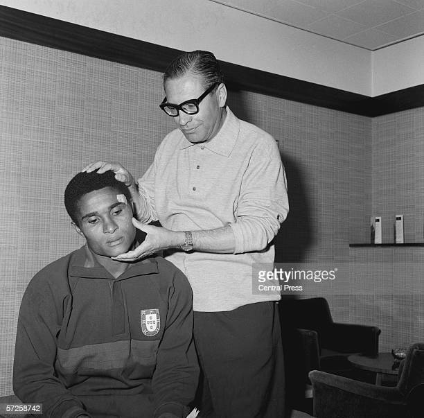 Portuguese team doctor Dr Jao Da Silver Rocha tending to the team's star striker Eusebio who sustained a head injury while Portugal played Hungary at...