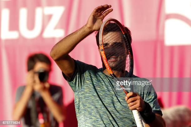 Portuguese tennis player Frederico Ferreira Silva acknowledges the spectators after winning his Millennium Estoril Open ATP Singles 1st round tennis...
