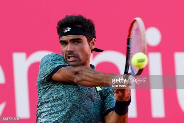 Portuguese tennis player Frederico Ferreira Silva returns the ball to Uzbekistan player Denis Istomin during their Millennium Estoril Open ATP...