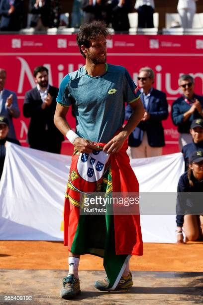 Portuguese tennis player Joao Sousa acknowledges the spectators after winning his Millennium Estoril Open ATP Singles final tennis match against...