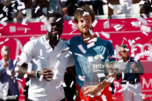 Portuguese tennis player Joao Sousa and NorthAmerican tennis player Frances Tiafoe hold their trophies during the award ceremony of the Millennium...