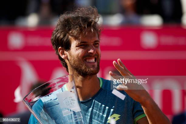 Portuguese tennis player Joao Sousa celebrates after winning his Millennium Estoril Open ATP Singles final tennis match against NorthAmerican tennis...