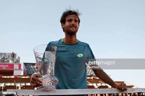 Portuguese tennis player Joao Sousa holds his trophy during an award ceremony after winning the Millennium Estoril Open ATP Singles tournament in...