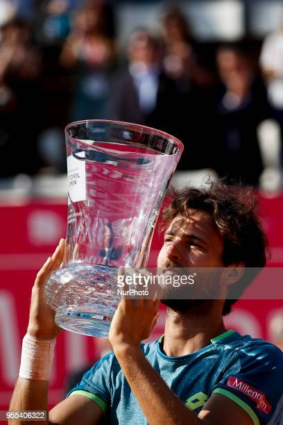 Portuguese tennis player Joao Sousa lifts up his trophy during an award ceremony after winning the Millennium Estoril Open ATP Singles tournament in...