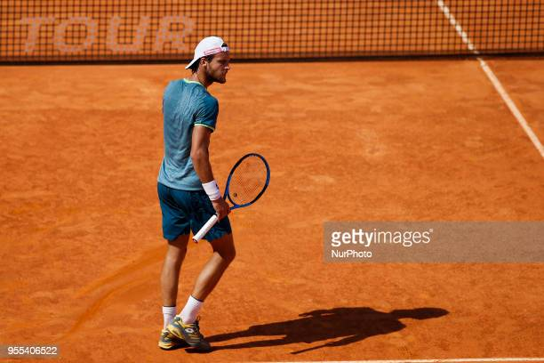 Portuguese tennis player Joao Sousa reacts after hitting the ball against the net during his Millennium Estoril Open ATP Singles final tennis match...