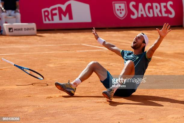 Portuguese tennis player Joao Sousa reacts after winning his Millennium Estoril Open ATP Singles final tennis match against NorthAmerican tennis...