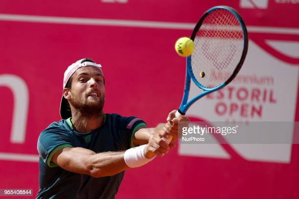 Portuguese tennis player Joao Sousa returns a ball to NorthAmerican tennis player Frances Tiafoe during their Millennium Estoril Open ATP Singles...